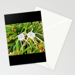 Pair of white flowers growing in the gardenbed Stationery Cards