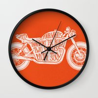 Four wheels transport the body, two wheels move the soul Wall Clock