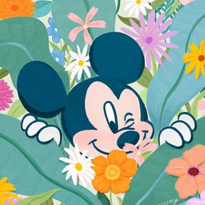 illustration of Mickey Mouse peeking his head out from a bed of flowers