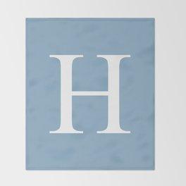Letter H sign on placid blue color background Throw Blanket