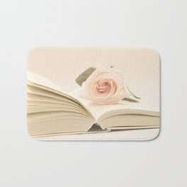 Soft rose on the book (Retro and Vintage Still Life Photography) Bath Mat