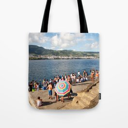 People waiting at the islet Tote Bag