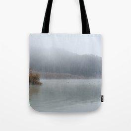 Wilderness lake. Foggy sunrise Tote Bag