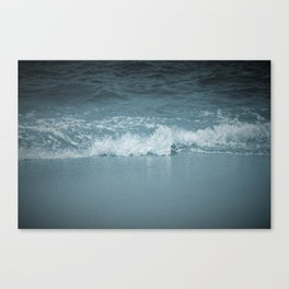 Wave splashing on a beach Canvas Print