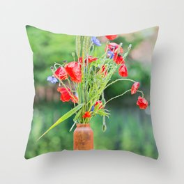 Bunch of of red poppies, cornflowers and ears of barley, wheat and rye on the table. Throw Pillow
