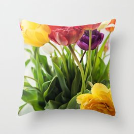 Multicolored tulips in a vase, window on the background Throw Pillow