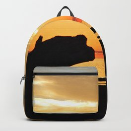 Silhouettes by the Sea at Sunset Backpack