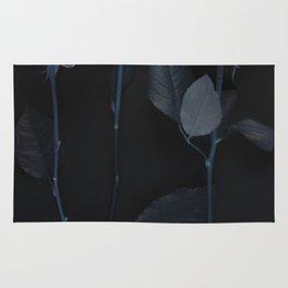 Blue roses on black Rug