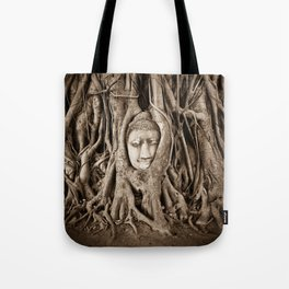 Buddha head in a Banyan Tree in Ayutthaya, Thailand Tote Bag