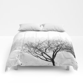 feral fruit tree in snow Comforters