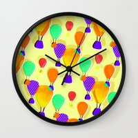 hot air balloons Wall Clocks featuring Hot Air Balloons (Yellow) by Ingrid Castile