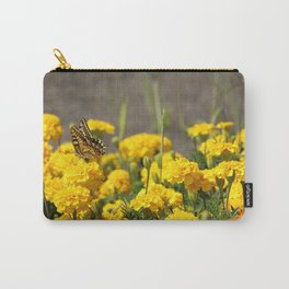 Lovely butterfly on yellow flower, with field of carnations on background Carry-All Pouch