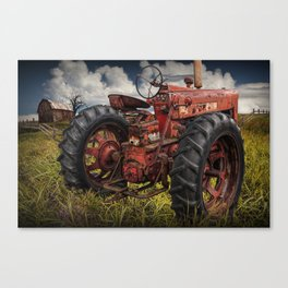 Abandoned Old Farmall Tractor in a Grassy Field on a Farm Canvas Print