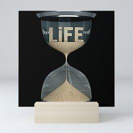 life time concept flows away like sand Mini Art Print