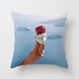 Hand holding melting ice cream in Santorini Throw Pillow