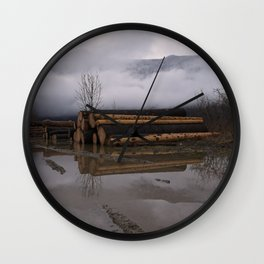 Timber Logs With A Foggy Mountain View Wall Clock