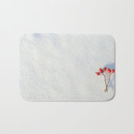 Fresh snow surface and a piece of hip twig on it Bath Mat