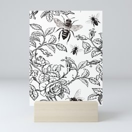 Roses and bees in black and white Mini Art Print