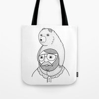 hats Tote Bags featuring On how baby bears are often used as winter hats by Michael C. Hsiung