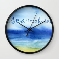 reassurance Wall Clocks featuring The Sea Is My Church (text) by Jacqueline Maldonado