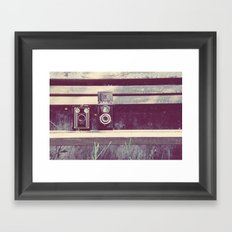 two cameras sitting on a park bench ...  Framed Art Print