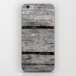 Grey boards with scattered fall leaves iPhone Skin