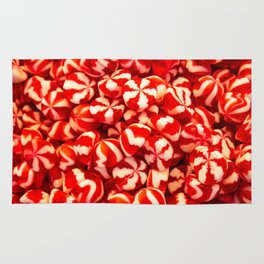 Confectionery of red and white colors with lines. Sweets two colors striped. Rug