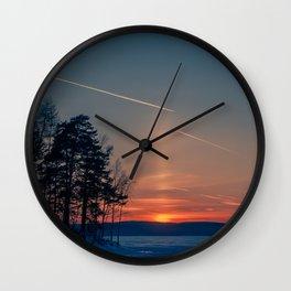 Flying at sunset Wall Clock