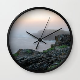 Mountains over the sea with orange mist Wall Clock