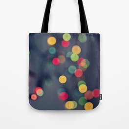 Blurred background with multicolored lights of garland Tote Bag