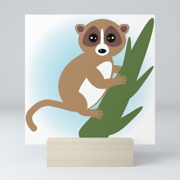 lemur on green branch on white background Mini Art Print