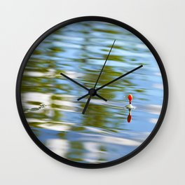 Fishing float on the water Wall Clock