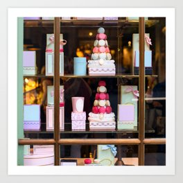 Beautiful colorful tasty macaroons cakes sweets and presents in the boxes display in window at the  Art Print