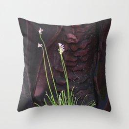 Long Stem Flowers Against Sculptured Rock Art Photo Throw Pillow