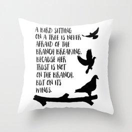 A bird sitting on a tree Throw Pillow