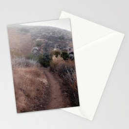 walkway with mountain view and dry grass field Stationery Cards