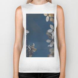 White Floral Pattern Against Blue Background Biker Tank