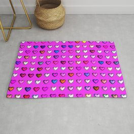 Metal hearts on pink background Rug