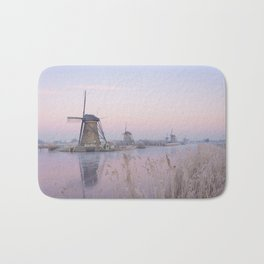 Pastel sunrise over windmills in winter in the Netherlands Bath Mat