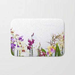 Different orchid plants on white background Bath Mat