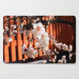 White plum blossom in a Japanese shrine Cutting Board