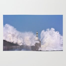 Stormy wave over lighthouse Rug