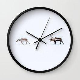Love follows the reindeers Wall Clock