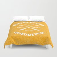 quidditch Duvet Covers featuring Hufflepuff Quidditch by Sharayah Mitchell