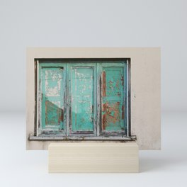 Window with turquoise blinds Mini Art Print