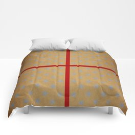 Present wrapped in gold paper and red ribbon Comforters
