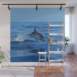 Spotted dolphin jumping in the Atlantic ocean Wall Mural