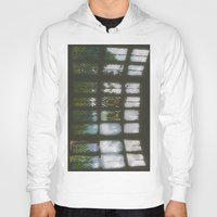 window Hoodies featuring Window by Aaron Carberry