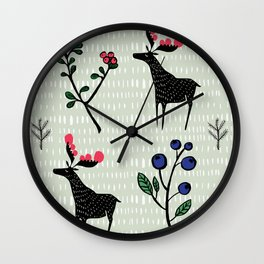 Berry loving deers on a green background Wall Clock