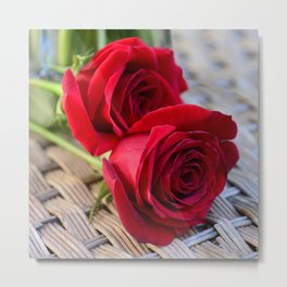 Two Elegant Red Roses on Rattan Table Metal Print